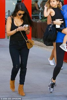 Kourtney Kardashian wearing Stuart Weitzman Grandiose Bootie and Saint Laurent Monogram Suede Shoulder Bag in Ocre