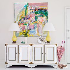 Pristine walls, floors, and trim serve as the perfect backdrop for this stunning abstract painting | Coastalliving.com