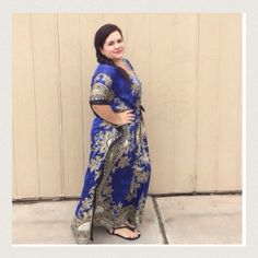 """Listing Exotic Blue Bejeweled Caftan The details in this piece is absolutely beautiful had a drawstring around middle for fitting perfectly. Has a silk like feel to it. 54"""" long 36"""" PTP. 100% poly. Wear with some jeweled sandals. Model says will fit up 3X. Boutique Dresses"""