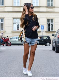 Black blouse, short jeans and white shoes