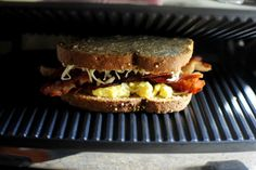 In this breakfast panini, scrambled eggs, crispy bacon and cheese pressed in between whole wheat bread for the ultimate breakfast panini! Breakfast Panini, Breakfast Sandwiches, Breakfast Recipes, Yummy Recipes, Yummy Food, Panini Press, Whole Wheat Bread, Paninis