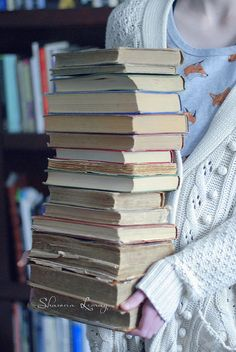 Tall stack of books by Shawna Lemay, via Flickr.