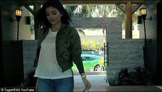 Arrival: The teenager wears a green bomber jacket and simple white linen shirt as she make...