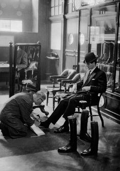 """a city gentleman maintaining his look by getting his shoes polished, london, 1954-1955[original] © frank horvat,fromlondon. portrait of a city. » notes:the original photo caption (see above) may be misleading or mistakenly described, because it appears to be the process of shoemaking, not shoe-shining. here's another caption fromhorvatland.com:""""customer at lobb's shoe shop, london, 1959"""""""