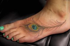 Gorgeous peacock feather foot tattoo.