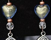 Dangle earrings w/ green foil & blue glass heart, clear crystal, copper beads and dangling silver charm, attached to copper fish hooks.