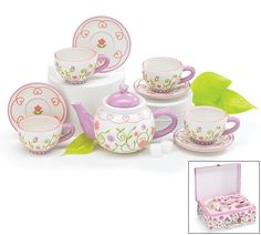 """CHILDREN'S TEA SET HAND PAINTED GIFT BOXED. This darling pattern is crisp and bright. Hand painted and embossed colorful florals. Food safe (FDA approved) but please hand wash. The set includes the teapot, which holds 11 oz and measures 4.25""""H and four teacups and saucers. The teacups hold 4 ounces each. The matching storage gift box with latch and handle is included - http://www.cherrygal.com/childrensteasethandpaintedgiftboxed-p-14432.html"""
