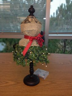 An easy, fun way to dress up your dress form for the holidays! Super easy and fun to make! I cut limbs from cheap artificial tree, wrapped them around pipe cleaner. Cut a small piece of burlap ribbon, folding the top over, tied with a piece of ribbon. Trimmed berries off an old ornament for accent.