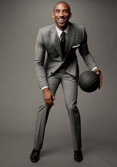 Kobe Bryant in a two button peak lapel euro style suit - Looking Sharp! The GQ Guide to Suits: Style: GQ Kobe Bryant Family, Kobe Bryant 24, Suit Guide, Kobe Bryant Pictures, Light Grey Suits, Gray Suits, Black Men In Suits, Fitted Suits, Bon Look