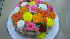 Flower basket cake full of multicolored roses