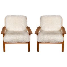 Pair of Sheepskin Covered Lounge Chairs by Glostrup | From a unique collection of antique and modern lounge chairs at https://www.1stdibs.com/furniture/seating/lounge-chairs/