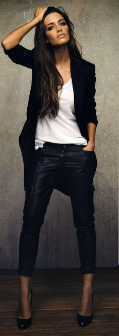 loose white t-shirt, black jacket and cropped slacks. kt