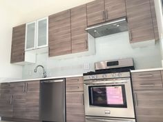 We love this IKEA kitchen we designed for our clients! They used BROKHULT doors and Frigidaire appliances.
