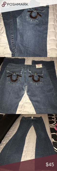 True Religion jeans!!! Really cute Flare Tru's. Brown symbolic the back packet also in from left side pocket. 99% cotton and 1% elastin. Inseam 33 and waist 15. A little wear and tear on the bottom of the jeans but you can't really notice it other than that no rips and holes. Feel free to ask any questions True Religion Jeans Flare & Wide Leg