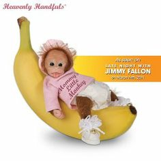 """Baby Jingles Doll by Ashton Drake by Ashton Drake. $29.99. This Heavenly Handfuls collectible baby monkey doll is superbly sculpted with a so-sweet-it's-silly facial expression, inquisitive eyes and true-to-life monkey hands and feet; what's more, she's covered head to toe with fluffy hand-applied mohair. Doll is costumed in a long-sleeved pink tee that says """"Mommy's Little Monkey,"""" coordinating cap, tiny diaper, fancy socks and wee baby shoes with golden jingle bells tied ..."""