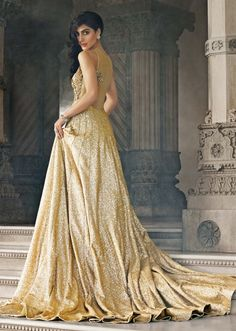 Gold gown featuring in sequine adorn in zardosi embroidery only on Kalki - Kalkifashion.com