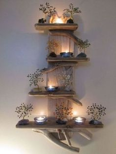 Using a short LED light string --- better than burning candles near wood--- or use flame-flickerbulbs in minicandelabra bases........with a regulat elec. cord..........................Driftwood Furniture Ideas 7