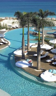 The million-dollar infinity pool snakes around wooden decks and palm trees. Turks and Caicos Vacation Places, Vacation Destinations, Dream Vacations, Vacation Spots, Dream Pools, Beautiful Places To Travel, Beautiful Beaches, Cool Pools, Travel Aesthetic