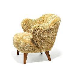 Flemming Lassen; Beech and Sheepskin Easy Chair by Jacob Kjaer, c1940.