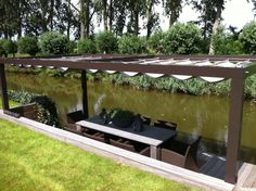 so a water garden is great When age-old around strategy, your pergola has been having Planter Boxes, Planters, Breezeway, Modern House Plans, Mid Century House, Water Garden, Coastal Living, Lawn, Eco Friendly