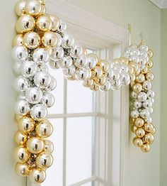 Metallic Window Dressing  Alternating stripes of gold and silver ornaments create a stunning Christmas valence above an otherwise undressed window. Wired together in a long ribbon, the metallic swag is arranged over hooks on either side of the window to drape the frame in an elegant, shimmering band.