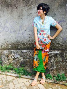 ..wearing Batik Amarillis's sugar and spices  series : Batik Amarillis sugar& spices kebaya, which features Polish embroidery on baby blue linen and Hand drawn Batik wonogiren in Ladybug series <3