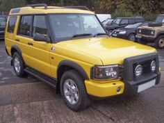 yellow land rover discovery 1
