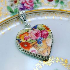 Broken China Jewelry Pendant Necklace Sterling Silver, Heart, Antique China Pink Roses, Vintage Wedding Necklace, Victorian Gift for Bride   ~ Carefully hand carved from an antique American china plate.  ~ Colorful bouquet of garden roses and forget me nots..  ~ One of a kind Victorian china pendant necklace.  ~ Choose 16 or 18 sterling silver snake style chain when ordering.  ~ Heart setting measures 1 1/4 wide and 1 1/4 tall.  Free shipping in USA ~ Jewelry arrives in a beautiful ...