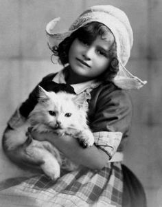 .Vintage Dutch girl with cat.