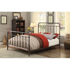 Features:  -Contemporary style platform bed.  -Material: Metal.  -Slatted head and foot board.  -Decorative spindle design.  -Roll-out trundle bed will not fit underneath the bed.  -Is designed to fit