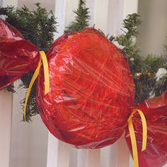 outdoor Christmas candy decorations made from Frisbees, cellophane, foil, ribbon