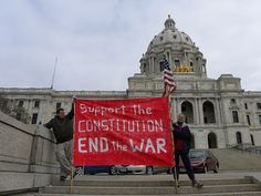 Anti-war protesters at the Tea Party Express rally in Minnesota.    This is great!