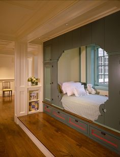 built-in bed, love this idea. maybe use the sides for book shelves in a kids room? or a guest room :)