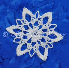 Snoqualmie Snowflake.... i just made four of these, but ran out of my silvery yarn