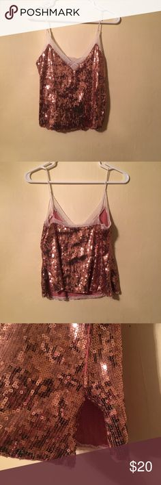 Sequins tank top Gold sequins tank top with a lace trim! NWOT, Bought this for New Years and never wore it :/ has a slight slit on the side as pictured. Size XS but can fit up to a medium. So cute and perfect for going out! Free People Tops Tank Tops