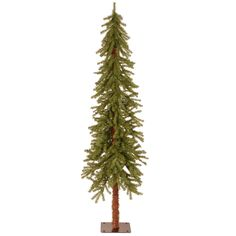 """This Pencil Christmas Tree Slim Artificial Wreath Stand Decoration Set measures 6 ft. tall with 28"""" diameter and has 476 branch tips. Fire-resistant and non-allergenic. Indoor or covered outdoor use. Packed in reusable storage carton."""