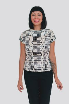 SENCHA Colette Patterns Simple, versatile blouse perfect for creative embellishment, with deep tucks at the front and back waist for a loose but curvy shape great for tucking in. Version 1 closes with back snaps, making it easiest to sew. Version 2 has neckline tucks and buttons up the back. Version 3 has a keyhole neckline with tie closure and buttons up the back.