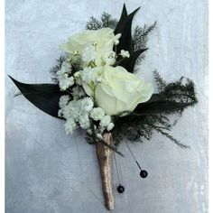 Double rose boutonniere with ribbon stem wrap and filler
