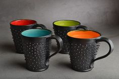 I love these!! They would make my morning coffee so much more interesting! Dangerously Spiky Mugs by Symmetrical Pottery
