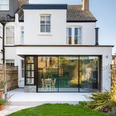 During this renovation, the rear ground floor rooms were opened up to create one large kitchen / dining and living space which flowed through into the garden through elegant Sieger® Slim #SlidingDoors. The three-track slim framed #slidingglassdoors featured one fixed pane and two sliding panes to create a wide opening that allows fresh air to flow throughout the property throughout the year when desired . #siegeraluminium #slidingdoor #maximumviews #beautifulviews Indoor Outdoor Living, Outdoor Living Areas, Living Spaces, Living Room, Aluminium Sliding Doors, Sliding Glass Door, Wooden Cladding, Kitchen Dining Living, Casement Windows