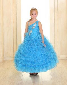 Girls Dress Style NP062 - TURQUOISE One Shoulder Organza Rhinestone Dress with Bolero  Watch heads turn in amazement when your little diva enters the room in this stunning gown. This organza dress features a one shoulder bodice richly decorated with beautiful large rhinestones. The great thing about the dress is that it comes with a matching bolero.  http://www.flowergirldressforless.com/mm5/merchant.mvc?Screen=PROD&Product_Code=CA_NP062TUR&Store_Code=Flower-Girl&Category_Code=Turquoise