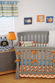 Owl nursery for baby boy with orange chevron, horizontal stripes and artwork by Judith Raye