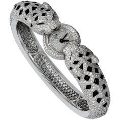 Panthères bracelet watch Quartz, white gold, diamonds, onyx, emeralds