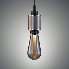 A single light pendant made from solid metal and finished with a matt black rubber cord.