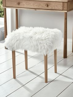 Carefully handmade in the UK, our sheepskin dressing table stool seat cover is crafted from 100% natural long haired sheepskin in a soft ivory colour. Rectangular in shape, with four slim, tapered birch wood legs, this sumptuous stool has an upholstered, padded seat with removable sheepskin. A brush is included for cleaning. Pair with our Bergen Oak Dressing Table to complete the look.