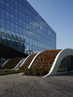 This children's area is linked to the new world headquarters of Japan Tobacco International in Geneva. Located between two imposing buildings, the headquarte...