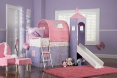 Princess Castle Twin Size Tent Bunk Bed with Slide Powell for a Princess. The Princess Castle Tent Bunk Bed with Slide includes a tent over twin bed and a covered hiding place below. The top of the slides is tented with a Princess Tower with pe