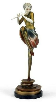 A PHILIPPE PATINATED BRONZE AND IVORY SCULPTURE ON A ROUND BLACK MARBLE TOP, SIGNED PHILIPPE ON THE BASE.