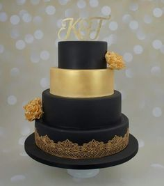 Black and gold wedding cake with gold flowers and gold lace detail