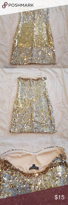 "Gold sequin dress As U Wish gold sequin strapless party dress. Excellent for NYE! Elastic around top to help keep dress in place without the constant pulling up. Good condition. Length- 25.5"" As U Wish Dresses Strapless"